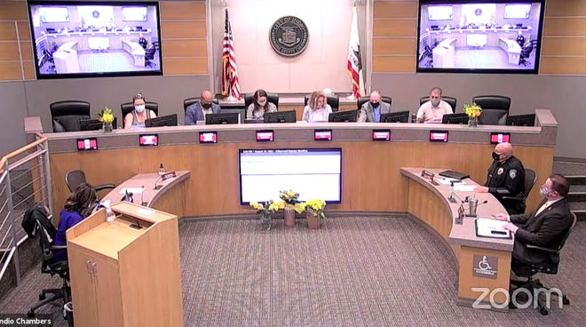 A screenshot of the Indio City Council's streamed meeting on Aug. 30, 2021. Yellow flowers were placed in the council chambers in honor of Cpl. Hunter Lopez, who was killed in Afghanistan.