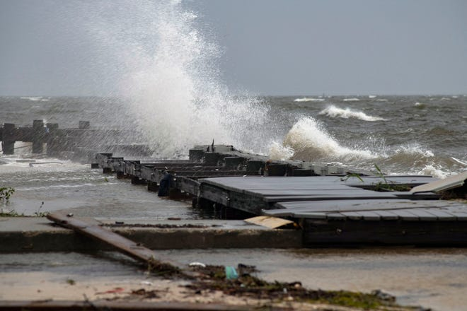 Waves whipped up by Tropical Storm crash along the seawall at Sanders Beach on Monday, Aug. 30, 2021.
