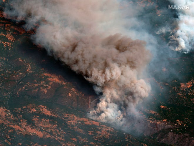 This  Aug. 25, 2021, satellite natural color image provided by Maxar Technologies shows the active fire line of the Caldor Fire near South Lake Tahoe, Calif.