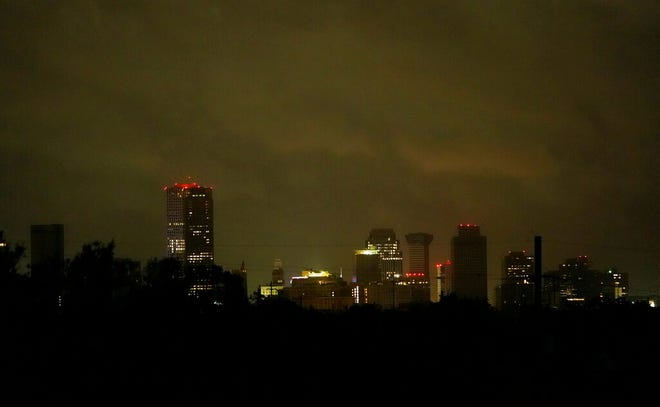Downtown buildings are lit by backup generators after Hurricane Ida knocked out power to the city, Monday, Aug. 30, 2021, in New Orleans, La. (AP Photo/Eric Gay)