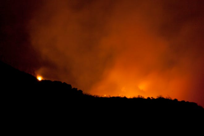 The Oak Grove fire, estimated to be 200 acres, is visible form St. George Sunday, Aug. 29, 2021.