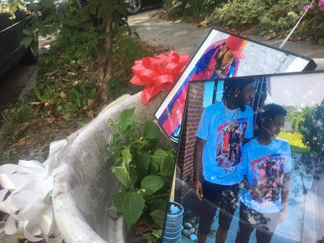 Pictures of Chinyelu Browne at a memorial for him on South First Avenue in Mount Vernon near where he was stabbed to death on Aug. 27, 2021