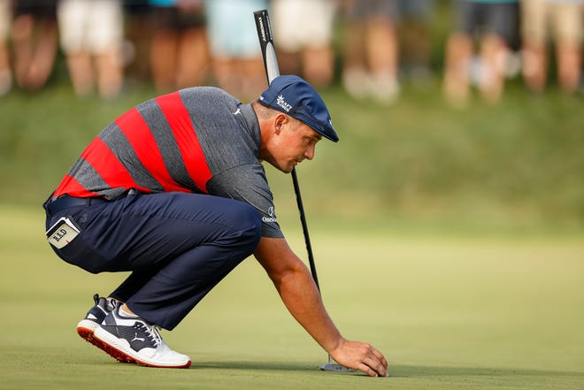 Bryson DeChambeau lines up a putt on the 16th green during the final round of the BMW Championship golf tournament.