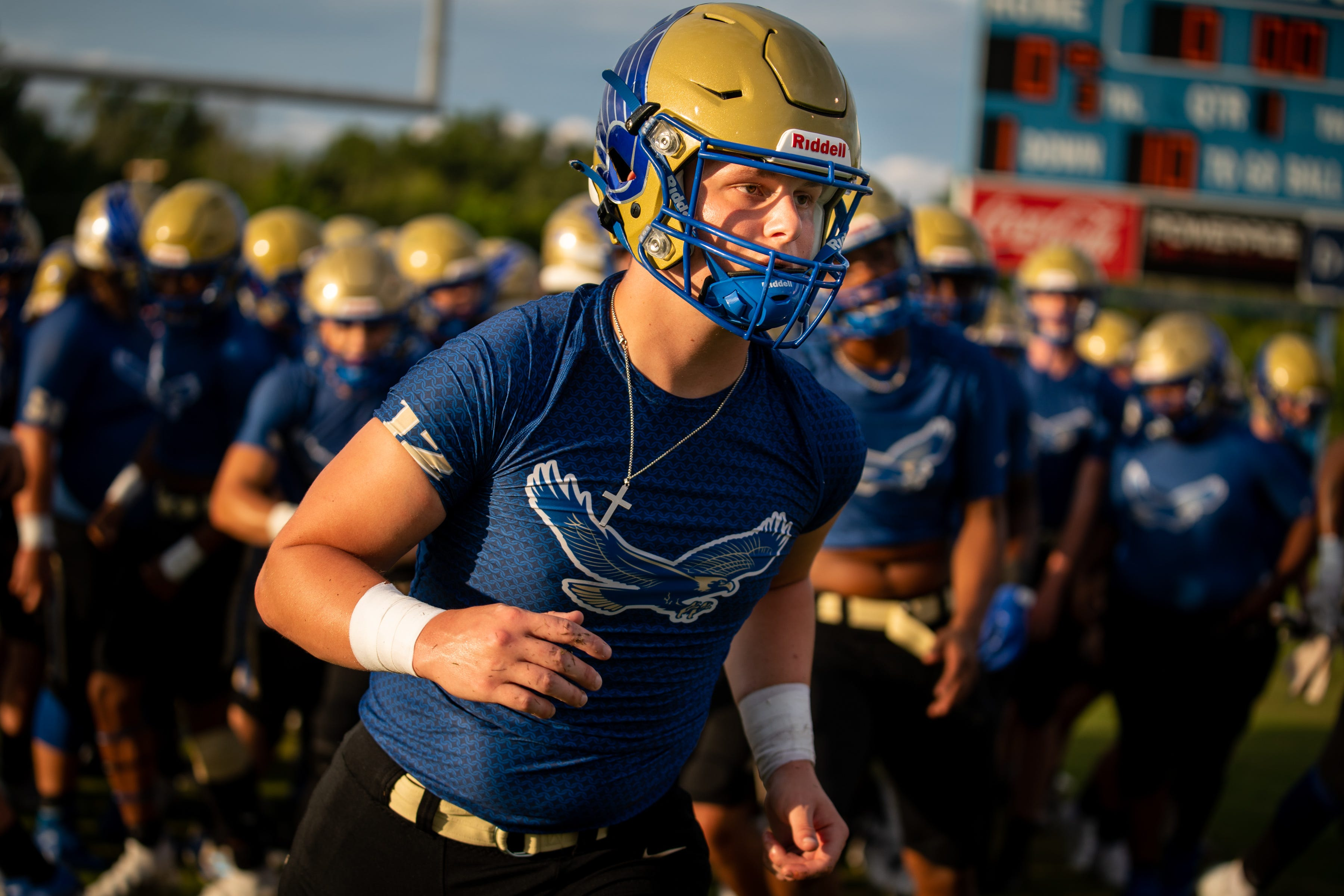 Shelbyville Central's Cayden Puckett (12) warms up before a game against Tullahoma at Shelbyville Central High School in Shelbyville, Tenn., Thursday, Aug. 19, 2021. Puckett returned to the field for the first time on Thursday, eight months after being diagnosed with COVID-19, and about seven months after learning he had myocarditis.