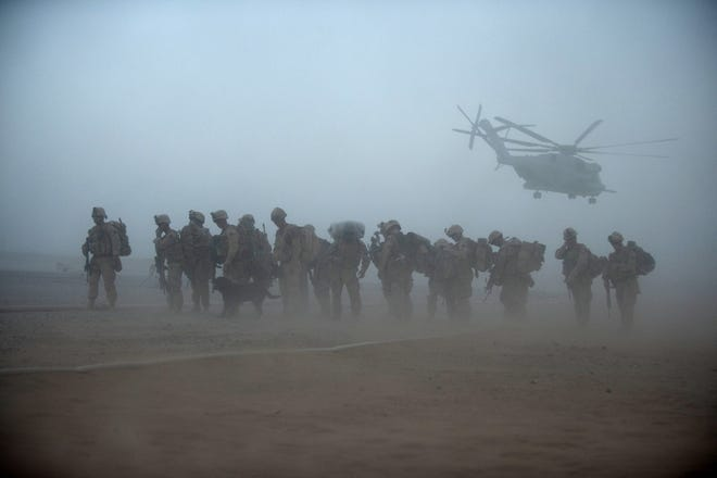 US Marines from the 2nd Battalion, 8th Marine Regiment of the 2nd Marine Expeditionary Brigade, wait for helicopter transport as part of Operation Khanjar at Camp Dwyer in Helmand Province in Afghanistan in July 2009.