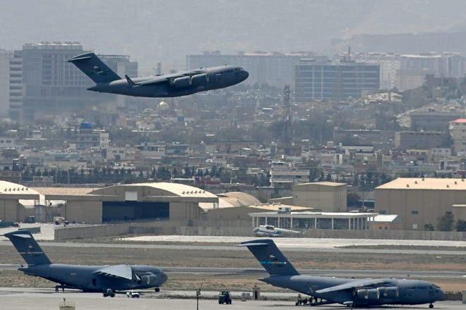 Aug. 30, 2021: An US Air Force aircraft takes off from the airport in Kabul.  Rockets were fired at Kabul's airport Aug. 30 where U.S. troops were racing to complete their withdrawal from Afghanistan and evacuate allies under the threat of Islamic State group attacks.