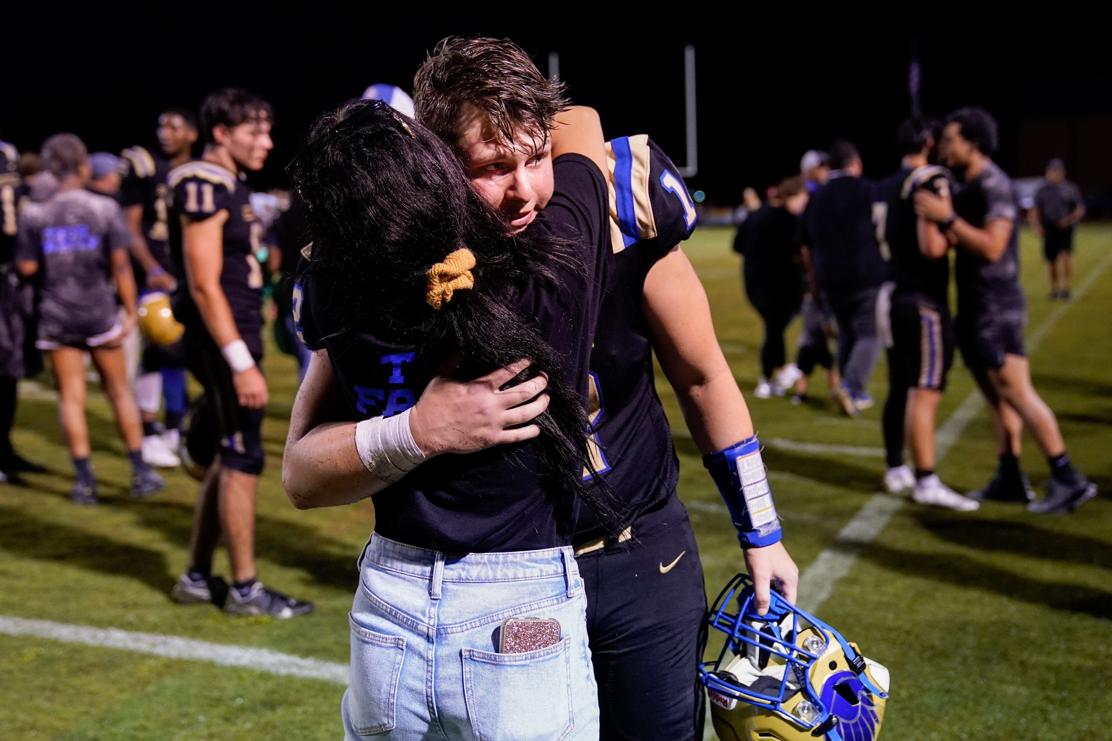 Shelbyville Central's Cayden Puckett (12) greets his girlfriend, Kinley Isbell, after his game against Tullahoma at Shelbyville Central High School in Shelbyville, Tenn., Thursday, Aug. 19, 2021. Puckett returned to the field for the first time on Thursday, eight months after being diagnosed with COVID-19, and about seven months after learning he had myocarditis.