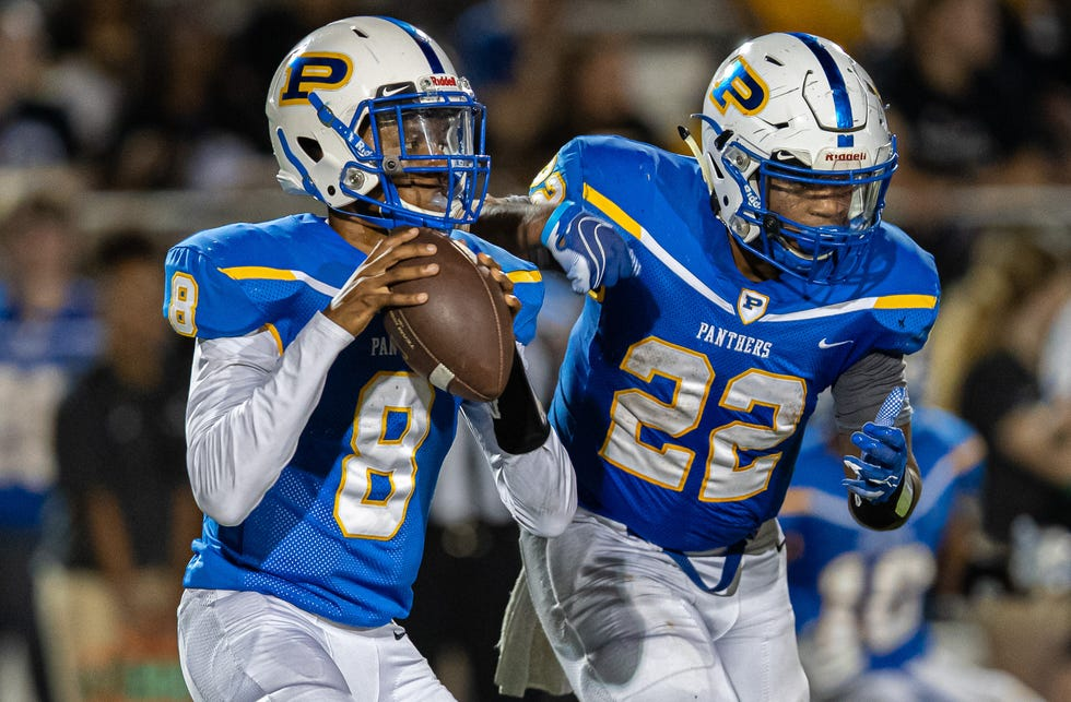 Quarterback Jaylon Reeves, left, said he has relied on his longtime friend Elijah Oakman to get through a difficult year. Oakman started to call Reeves daily after the senior Panther's parents died from COVID-19 in February.