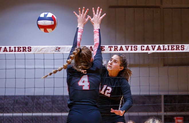 Lake Travis outside hitter Arden Besecker fires a shot against Churchill earlier this season. Besecker accumulated 81 kills, made 95 digs and had nine blocks to earn all-tournament honors and help the Cavs finish fourth at Volleypalooza.