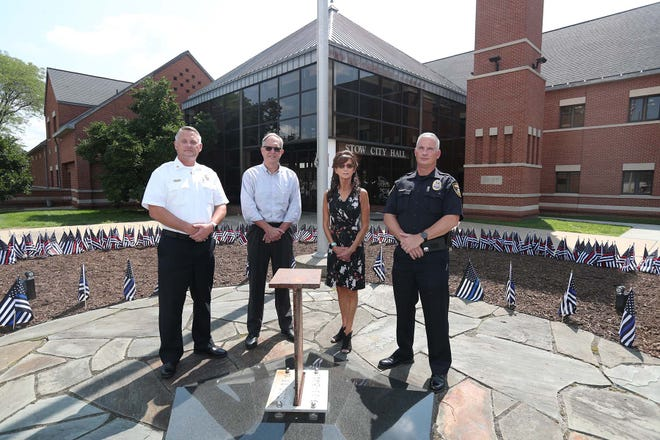 Stow Fire Department Chief Mark Stone, left, Stow Mayor John Pribonic, Parks and Recreation Director Linda Nahrstedt and Stow Police Department Chief Jeff Film are planning the city's 9/11 Memorial Ceremony, which this year marks the 20th anniversary of the attacks. The ceremony will be held at the 9/11 Memorial Garden, which features a steel beam from the World Trade Center.