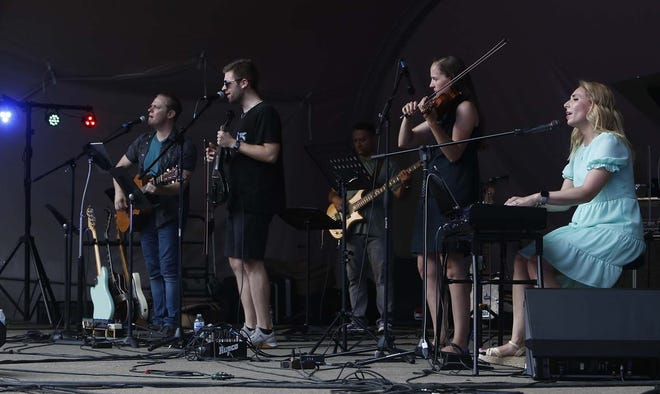 The band Mercy Devine performs during Amplify Faith, a family music festival sponsored by Ss. Cosmas and Damian Parish and the city of Twinsburg at Glen Chamberlin Park on Aug. 28. Jeff Andrea and his wife Kira Leyden Andrea are from Cuyahoga Falls.