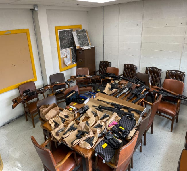 Guns seized during a search in Brimfield Township.