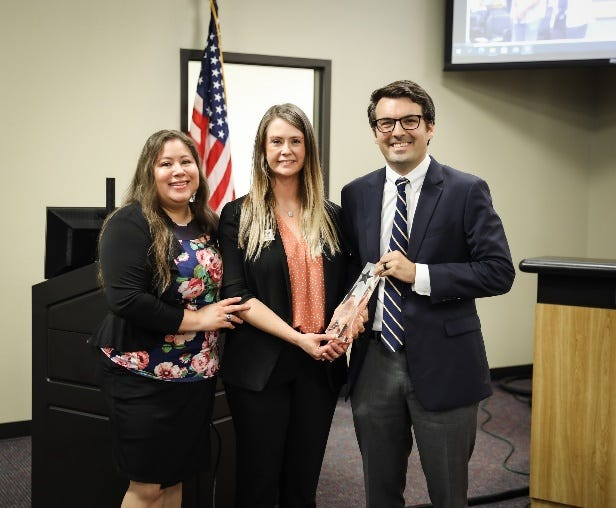 The city of Anna's human resources duo ofRhandyPeña(left) and Director Stephanie Beitelschieswere recognized by Assistant City Manager Ryan Henderson during the Aug. 24 City Council meeting.