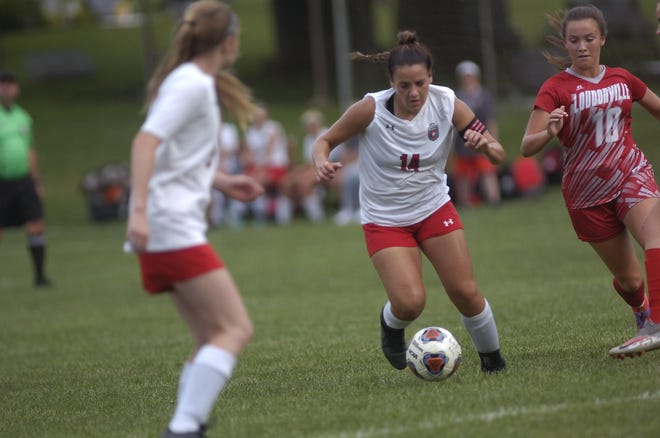 Crestview High School's Mary Leeper (14) moves past Loudonville High School's Taylor Edes (10) during soccer action Monday in Loudonville.