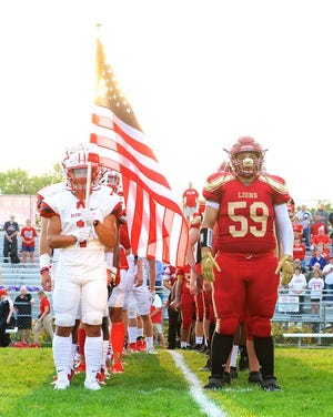 New Brighton and Avonworth take the field prior to the start of a  WPA Gold Star game in the fall of 2019 at New Brighton.