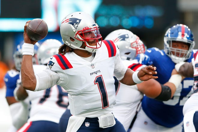 Patriots quarterback Cam Newton throws a pass in a preseason game against the Giants on Sunday.