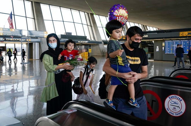Afghan refugees arrive at Dulles International Airport in Northern Virginia while en route to military facilities in the U.S.