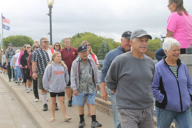 In 2019, there were a number of people who came out and walked across State Street Bridge in the City of Cheboygan. Many of them had also walked across the Mackinac Bridge earlier that day.