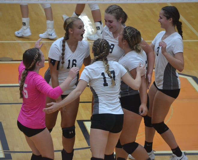 Cheboygan varsity volleyball players celebrate a point during the third set of a non-conference matchup against Gaylord at home on Monday night.
