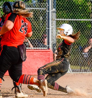 Senior leadoff batter Sophia Luetticke of the 2021 Chillicothe (Mo.) HS softball Lady Hornets slides into home plate to score the only run of Monday's (Aug. 30) home win over Kirksville. Luetticke led off the bottom of the sixth inning of the then-scoreless game with a bouncing single into right field. After a wild pitch let her take second, she aggressively darted for third when a 2-outs pitch went in the dirt and rolled a couple of feet in front of the KHS catcher. Luetticke and the catcher's throw to third arrived at about the same time and, in that hubbub, the third baseman had the throw elude her and skip down the left-field line, allowing the Lady Hornet to dash home without a play. When pitcher Kinlei Boley retired the Lady Tigers in order again in the seventh – she held KHS hitless after the first frame, CHS impressively had its fourth victory in six games thus far this season.