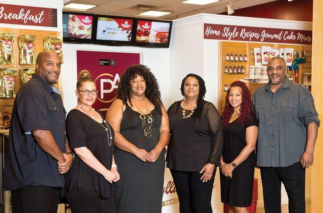 Owners of Phyllis Ann's Family Recipe (left to right) Rodrigues Carter, Nicole Carter, Tanikia Carter-Camara, Katherine Carter-Sylva, Dawanna Carter and Tony Carter