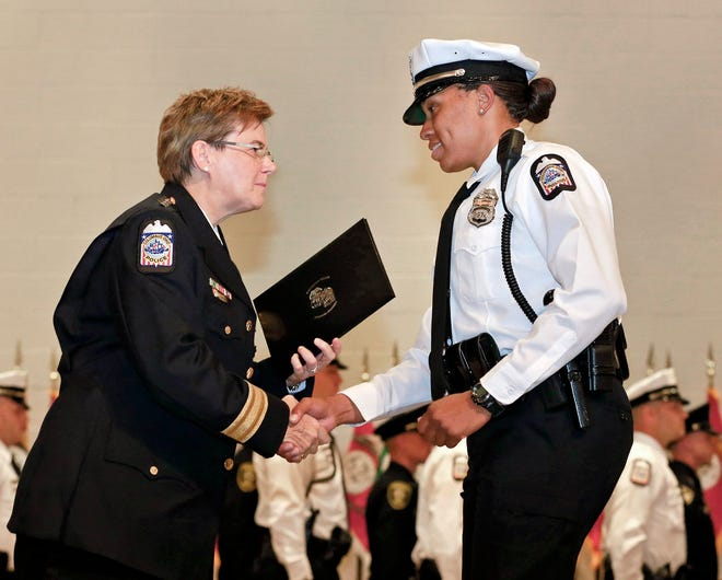 Blair Stewart accepts her certificate from then-Chief Kim Jacobs in 2017 as a graduate of the Columbus Police Department's 127th recruit class.
