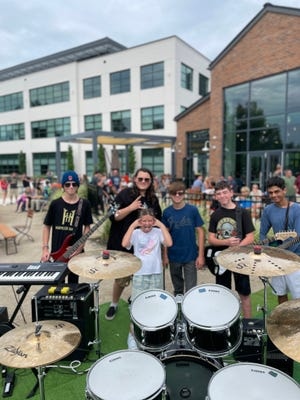 The School of Rock House Band will perform at 5 p.m. Sept. 17 at Creekside's Round Stage. The band includes (from left) Matthew Peck of Gahanna (drums, bass), Jason Fisher of Gahanna (guitar, keys), Emma Jenkins (front) of Gahanna (vocals, guitar), Cayden Reed of Circleville (drums, bass), Christian Estep of Westerville (guitar, keys) and Nishil Sharma of New Albany (guitar, keys).