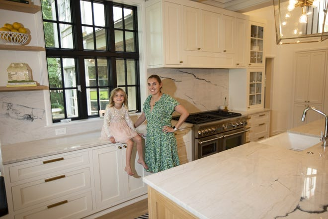"""MaryAllison Comfort and her daughter Cecilia, 5, in the family's recently remodeled kitchen. """"I'm in here all the time,"""" Comfort said. """"This is the heart of the home."""""""