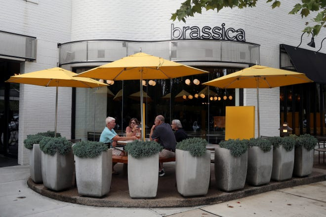 Patrons enjoy food and drinks at Brassica on Aug. 16. Brassica is one seven establishments participating in the Bexley Patio, the city's version of DORA.