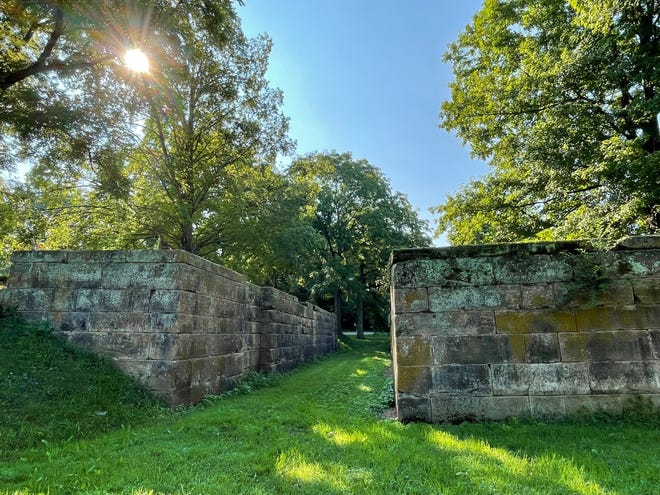 The sun rises over the ruins of a historic lock at Lockville in Fairfield County.