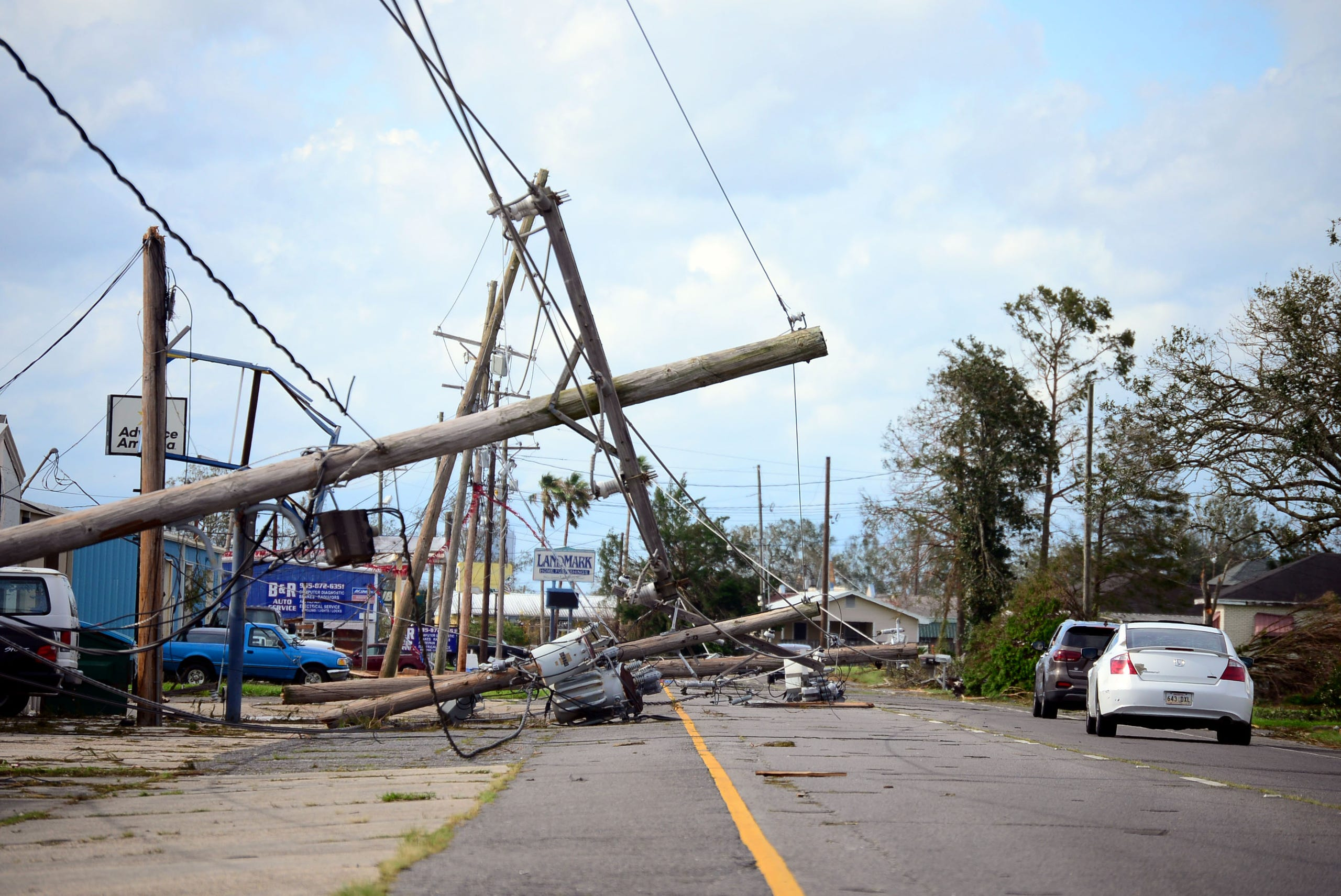 Downed powerlines are seen along Park Avenue in Houma, La., on Monday, Aug. 30, 2021.