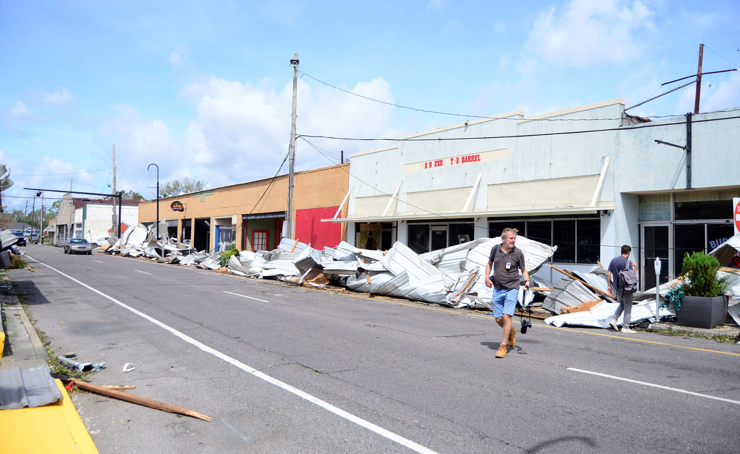 Debris is seen along the streets of Houma's downtown area on Monday, Aug. 20, 2021.