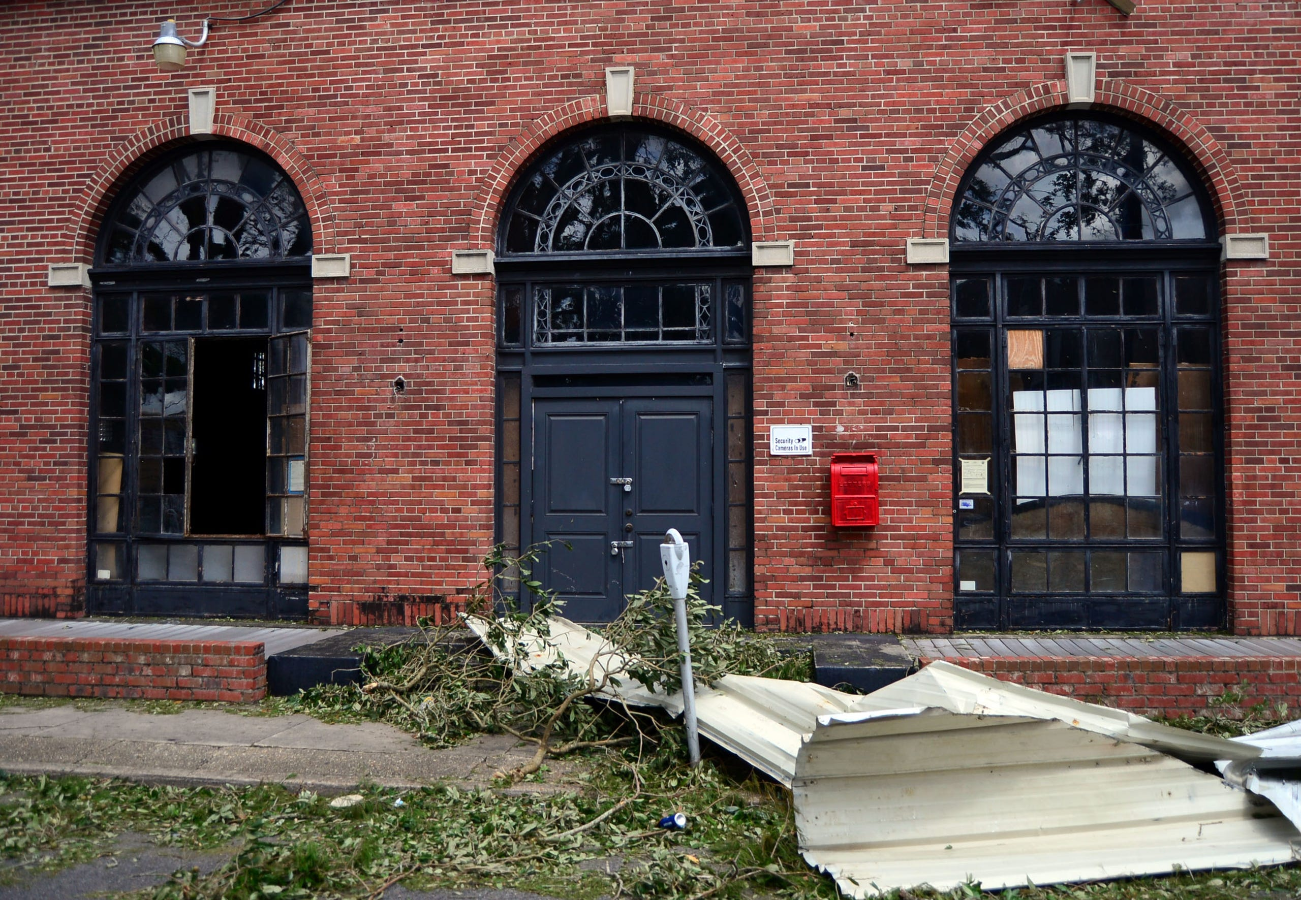 Storm debris is seen outside a building in Houma, La., on Monday, Aug. 30, 2021.