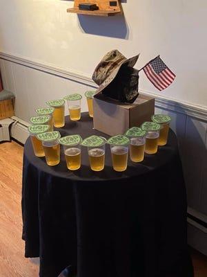 Dover Moose FC-Lodge 443 set aside 13 beers in memory of the fallen service members who died in Afghanistan last week.