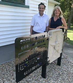 Ronald and Teri Pankau are pictured with the display their family owned Galva business, John H Best and Sons  fabricated and donated to the Galva Historical Society to hold the cement star from the former Best building in downtown Galva that was torn down. The cement star was one which was around the top of the old building.  The demolition crew saved one of them and gave it to the Galva Historical Society. The Ronald and Teri were present Saturday afternoon during an open house held at the Wiley house museum at 906 West Division  in Galva to honor the John H. Best family owned business. Everyone who attended were treated refreshments which included homemade star cookies.The museum  which is full of Galva items is open on Wednesday and Sunday afternoons from 1 – 4 p.m.