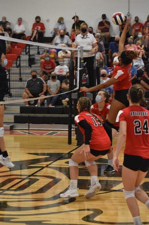 Orion hosted Ridgewood on Thursday, Aug. 26. Early in the second game, Mimi Carter goes up for a shot. Also on the floor, front to back, are Rachel Bowers (24), Kennedy DeBaillie (15) and Ella Sundberg. After falling 25-14 in the first game, the Chargers won the second game 25-17 only to lose the third game 25-20.