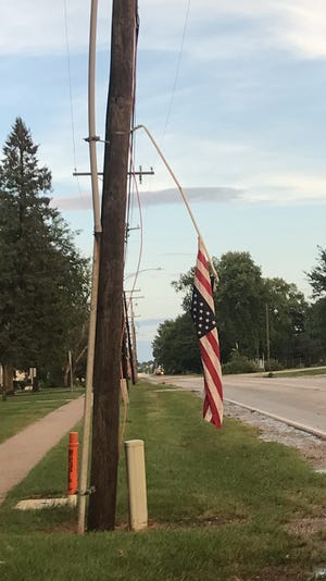 Pictured is one of the flags on the poles that was damaged on Depot Street in Altona. The winds damaged most of poles during Wednesday's storm along the street.  Corn was damaged along Route 34 just north of Altona from the winds.