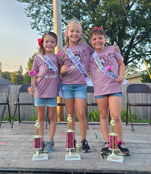 Kynlee Adam, center, daughter of Sarah Combs and Jamie Adam, was crowed 2021 Little Miss Flame, Kammi Castillo, daughter of Niki McKeag, was first runner-up; and Elaina Massingill, daughter of Brian and Julia Massingill, was second runner-up. This year marked the 25th anniversary of the pageant.
