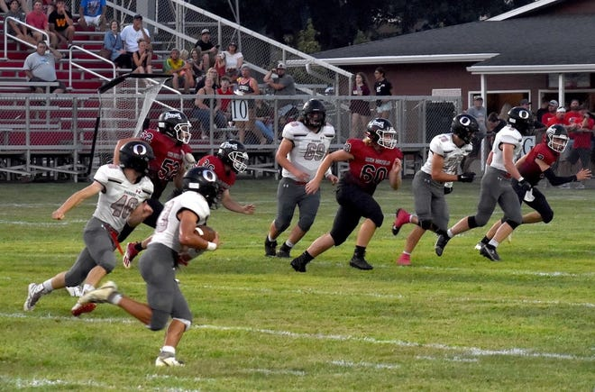 Orion's Cole Kratzberg picks off a pass and scores early in the second quarter of the game on Friday, Aug. 27, at Spring Valley Hall. Escorting him down the field are, from left, Tyler Anderson (40), Seth Gardner (69), Luke Dunlap (76) and Duncan Adamson (9).