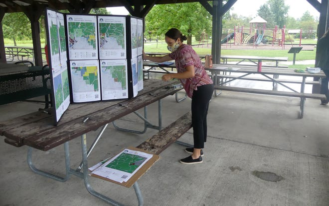 Jacqueline Nester Jelen, assistant director of the Monroe County Planning Department, sets up a board that displays every township's current and proposed zoning districts.