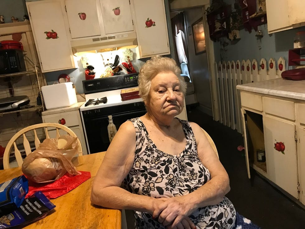 Esther Bugg, 76, grimaces in her South Peoria kitchen on Tuesday, Aug. 31, 2021, as she talks about a recent home invasion. After a hospital stay for pneumonia, she went home. During her recuperation, her health insurance paid for two weeks of delivered meals. But in a break-in, everything vanished from her freezer, including her delivered meals.