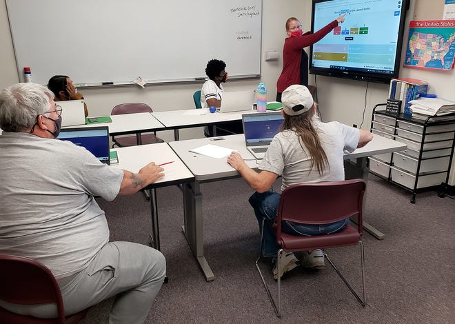 Megan Wenzel teaches math to students on Aug. 19, 2021, during a Highland Community College Adult Education class.