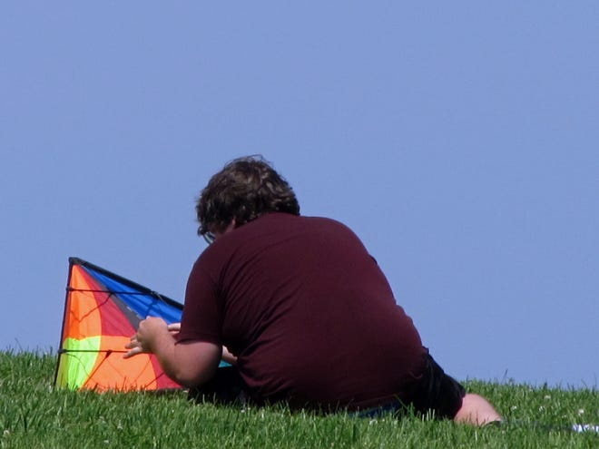 Flying kites at Castle Island is a lot of fun – once they are ready to get into the air.