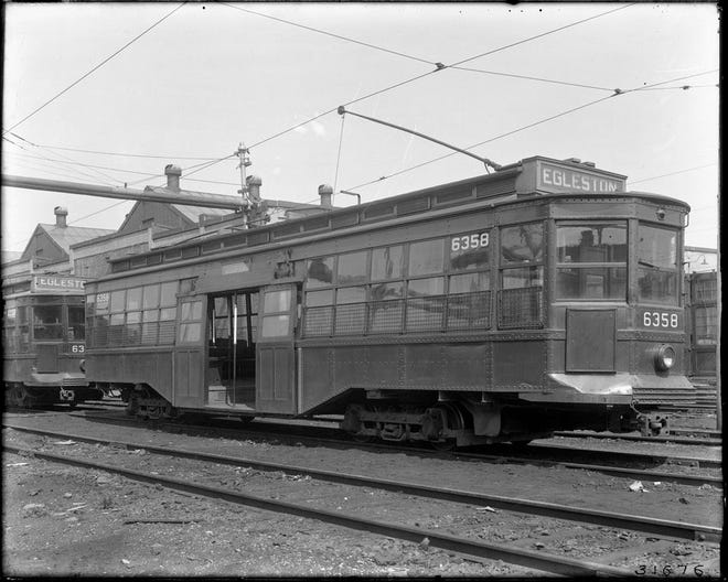 This is an old Egleston Trolley sitting in the Arborway Yard. Learn more from Digital Commonwealth at www.digitalcommonwealth.org.