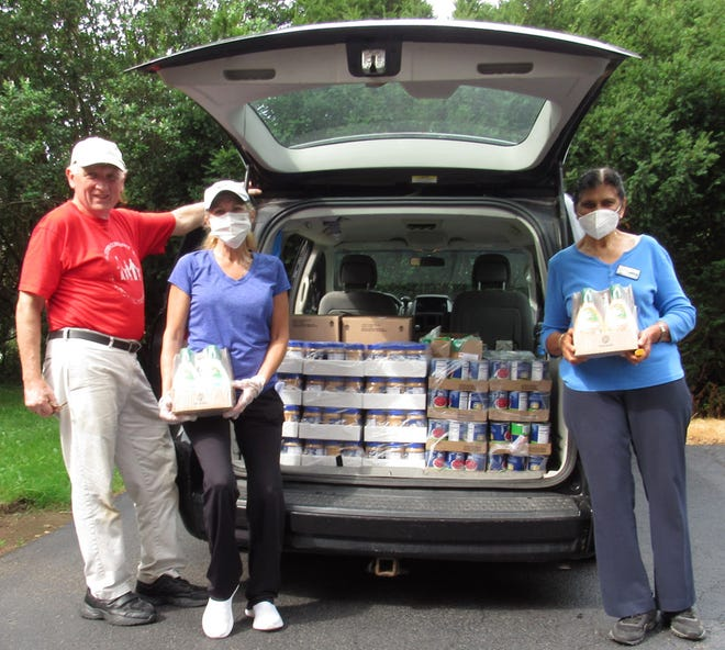 Webster Community Chest supports HOPE Ministries through food and household item donations, and its annual school supply distribution. Pictured, from left, are Michael Grenier, president of the WCC board, with HOPE volunteers Elaine and Sureka.