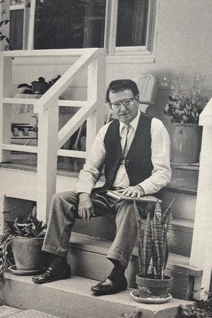 George Scarborough sitting on his porch in 1989.