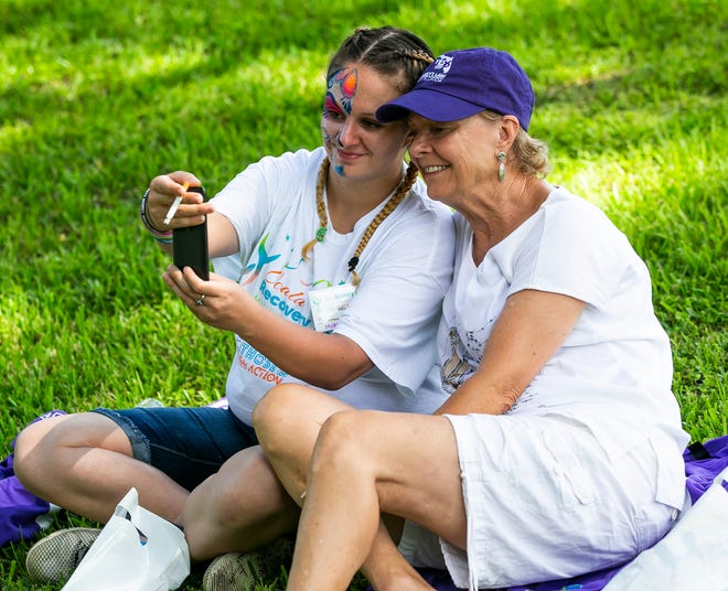 Adrianna Clements, left, takes a selfie of herself and her mom Cathy Clements, right, while attending the second annual Ocala Recovery Fest, held Sept. 8, 2008 at Tuscawilla in Ocala. This year's Recovery Fest will take place at the park on Saturday, Sept. 11, from 10 a.m. to 2 p.m.