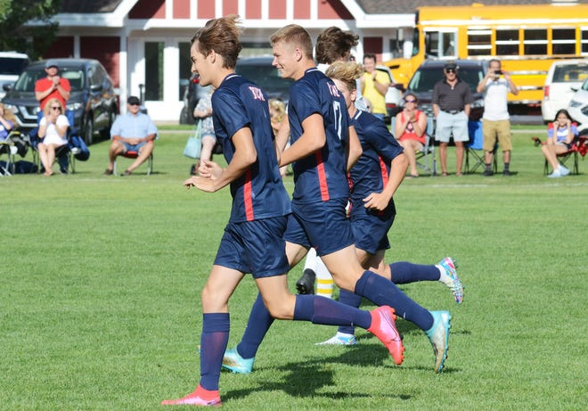 Boyne City players run back up field after Austin Mercer (middle) scored his second goal of the first half against North Bay Monday.