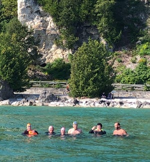 Local swimmers Alfie Zarate, John Marshall, Ashley Sigman, Martha Jansen, Matt CasaSanta and Dan CasaSanta competed recently in the annual Mackinac Island Swim, a fundraiser event.