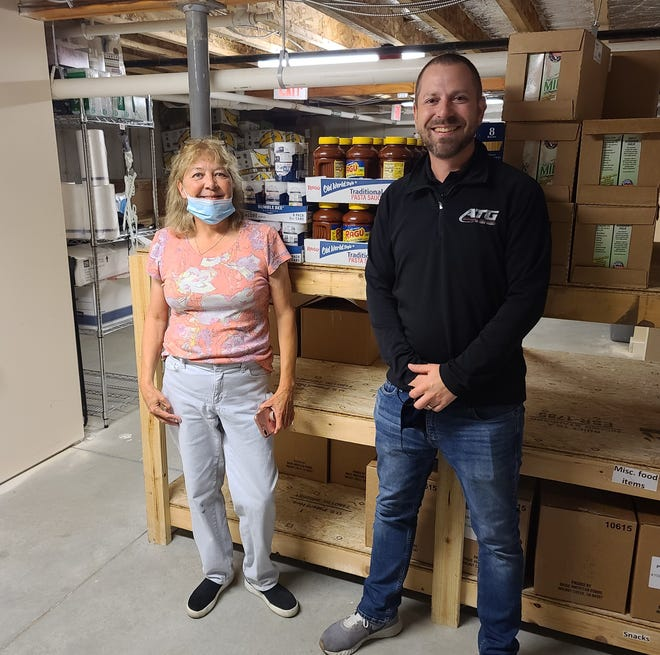 Advantage Truck Group parts director Mike Ramian donates 25 cases of tuna fish to Rockingham Community Action food pantry in Seabrook through the company's Haulin' 4 Hunger program.